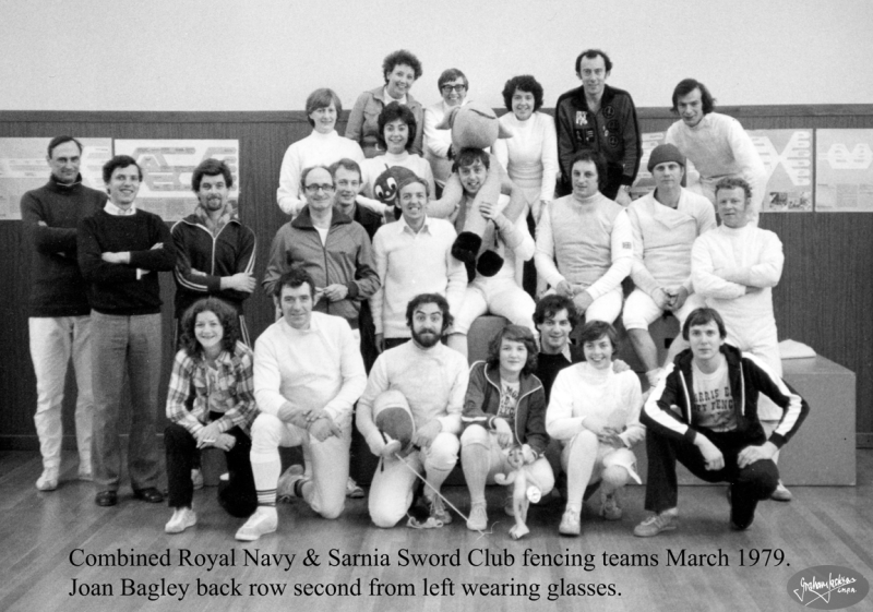 Combined Royal Navy & Sarnia Sword Club fencing teams March 1979. Joan Bagley back row second from left wearing glasses. © Graham Jackson.