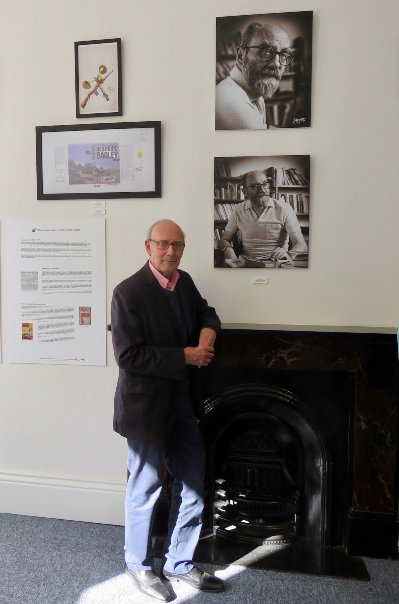 Graham Jackson pictured with two of his portrait photographs of Desmond Bagley at the Guille-Allès Library, Guernsey May 2018 © The Bagley Brief.